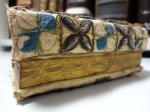 Detail of the gilt and gauffered fore-edge and of the embroidered spine of Bib BS2085.C27
