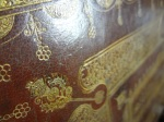 "Detail of the thistle ornament on the front cover of ""The laws and acts of Parliament,"" printed 1681."