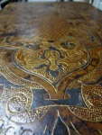 Detail of the front cover of the 16th century French 'fanfare' style binding.