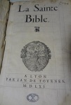"""Title page of  the 1561 printing of """"La Sainte Bible"""" featuring the printer's device of Jean de Tournes."""