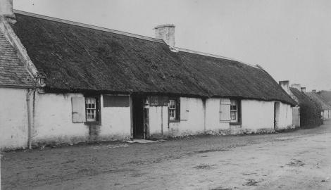 Old photograph of Robert Burns boyhood home set in the village of Alloway in which the poet was born during a snowstorm on 25 January, 1759 (Valentine collection in a scrapbook album (VGA 101).