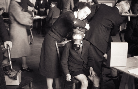 """Gas Mask Fitting, St Andrews"" by George M. Cowie, 1940."