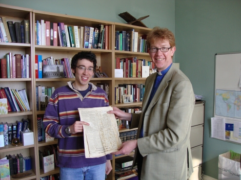 Peter Reader-Harris (left), great-great grandson of Richard Reader Harris, with University Chaplain Revd Dr Donald MacEwan (right) and the pages of Tongues of Fire.
