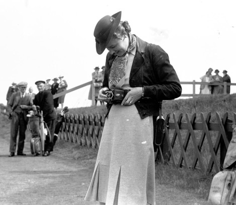 'Woman with camera, Open Championship at St Andrews,' by G.M. Cowie, 1939 (St Andrews GMC-FG-111B-7)