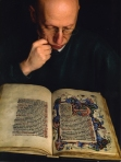 "Norman Reid, Head of Special Collections, with the ""St Andrews Psalter"" (photograph by Peter Adamson)"