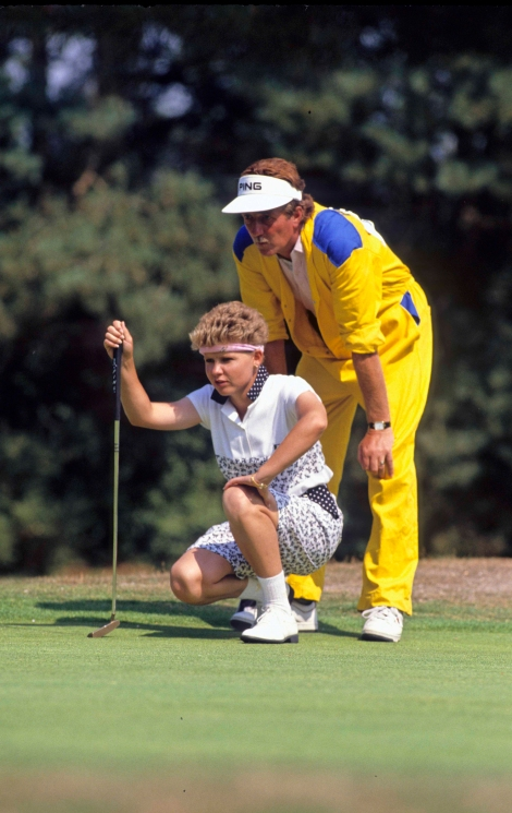 Laurette Maritz lines up her putt with her caddie at the Women''s British Open, Ferndown, 1989.