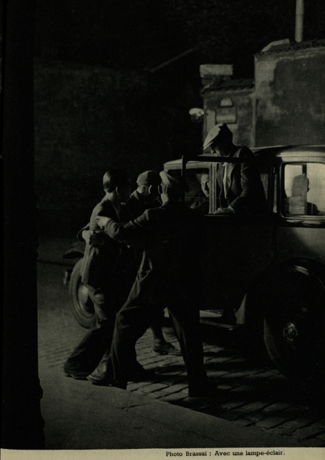 An example of Brassaï's mastery of flash photography in the dark streets of Paris, from Éclairages artificiels (St Andrews copy Photo TR590.N38)