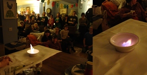 The audience is transfixed by the effect of Copper Nitrate and Bio-Ethanol on the left, and the purple flame of Lithium Chloride and Bio-Ethanol on the right.