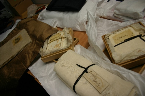 Several of Johnstone's books in their various housings: cloth, wooden boxes and paper.