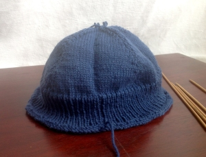 "The ""finished"" cap.  Sadly too short to fit an adult head, this one is destined to be unravelled and knitted up with a much longer ribbing."