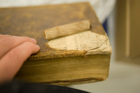Torn leather on the back board of St Andrews r17 DG676.3M7 revealed more sheets of the same catechism had been used to make the boards of this book.