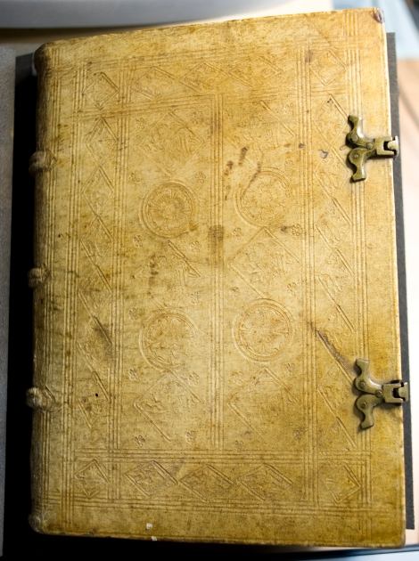 The front board of vol. 1 of the 1489 printing of Alexander of Hales's Summa universae theologiae; bound in pigskin on wooden boards and decorated with various blind stamps.