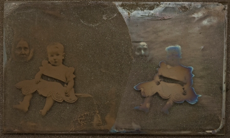 Pair of portraits, mother with small child [PHtempSB1-1]. Unvarnished half of image shows extensive tarnishing.