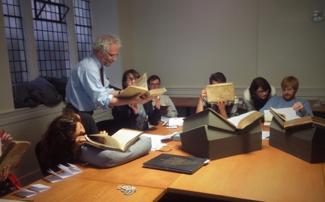 Prof. Neil Harris leads the group in  looking for watermarks in 15th and 16th century books from Special Collections.