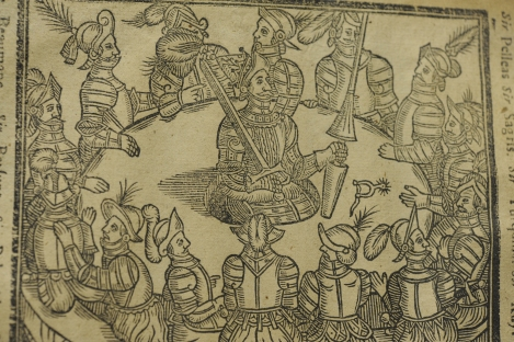 Detail of the woodcut of King Arthur literally in his roundtable, used in the 1634 edition of Malory's Morte d'Arthur.
