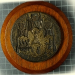 University seal matrix (1414x18), whose imagery includes heraldic insignia of the founders, and perhaps a rectorial court with bedellus holding the mace.