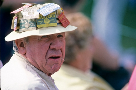 A veteran of many Masters, this patron chews a toothpick at the 1985 Masters (Photograph © Lawrence Levy Photographic Collection. All rights reserved. Image courtesy of the University of St Andrews Library, [2008-1-1764]).