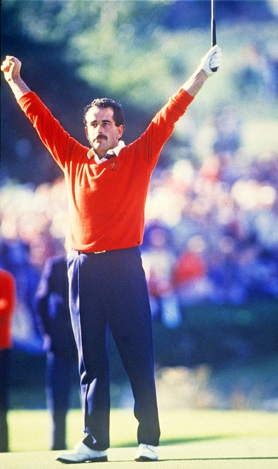 European golfer Sam Torrance holes his putt on the 18th hole to give Europe the victory at the 1985 Ryder Cup at The Belfry (Photograph © Lawrence Levy Photographic Collection. All rights reserved.  Image courtesy of the University of St Andrews Library, [2008-1-7362]).