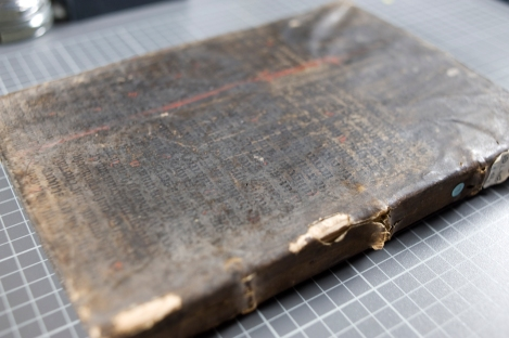 The front cover of TypFL.B47GS, bound in a leaf of a 15th century manuscript Bible which has been washed black, written in gothic textualis script, and comprising part of 1 Kings, chapter 18.