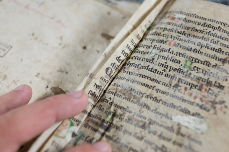 Two fragmentary leaves of a 12th century manuscript have been sewn into the front and back of TypFL.B47GS.