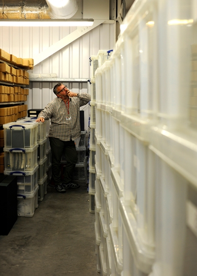 Levy Cataloguer, Trevor Ledger, considering where to go next in the 'wall of Levy' slides