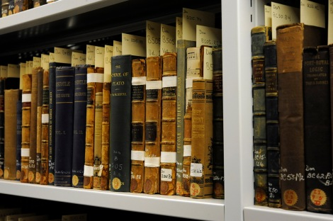 Some of the Philosophical books of the Donaldson Collection. Note the book towards the right with the spine damage showing musical notation from a text used in the binding.