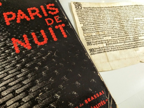 "My two favourite acquisitions as Rare Books Librarian side-by-side: the inky, murky noir delight that is Brassaï's Paris de Nuit (1933) & a 1487 indulgence, printed on vellum in Cologne and issued to a ""Johan le Brebsotte"" and his wife"