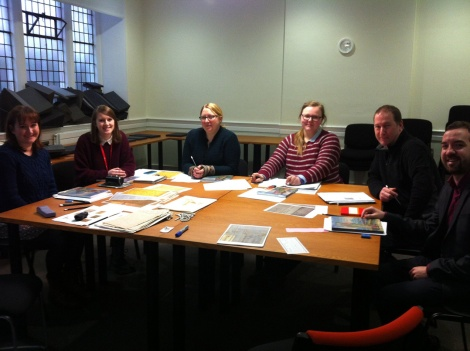 Anabel and her fellow trainees enjoying a palaeography taster session on the cohort visit to St Andrews